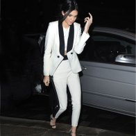 Kendall Jenner breaks up an otherwise all-white look with black tuxedo stripes.